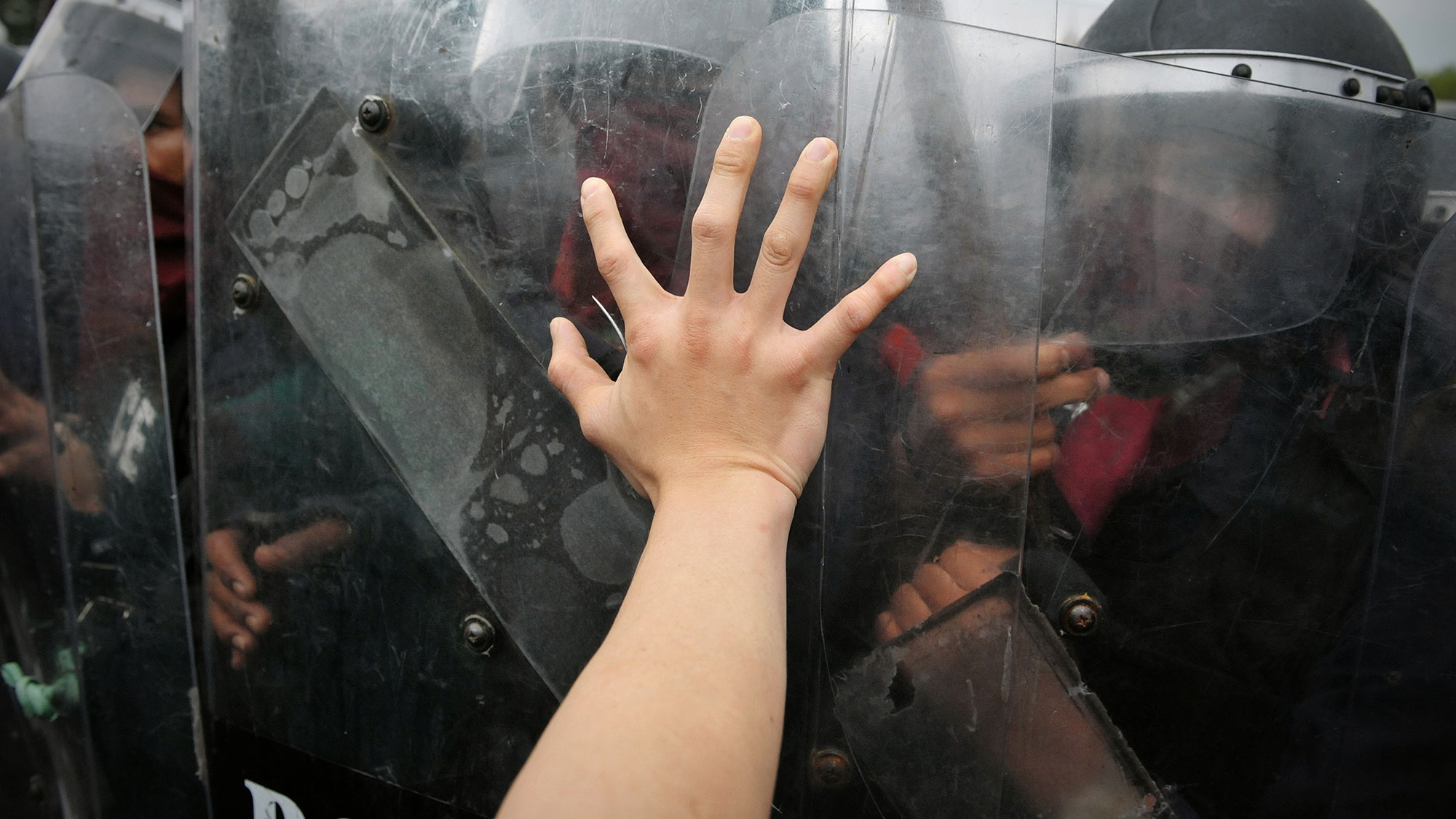 Protester clashes with police at a political rally.