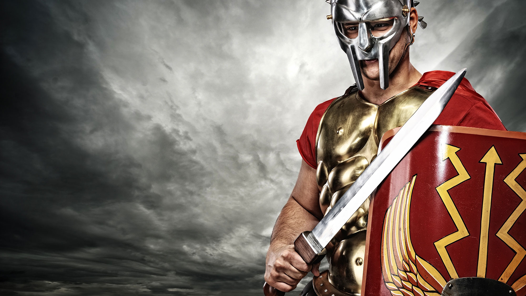 A Spartan soldier with armor and a sword.