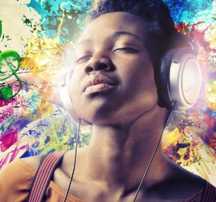Girl listening to music with a pair of headphones.