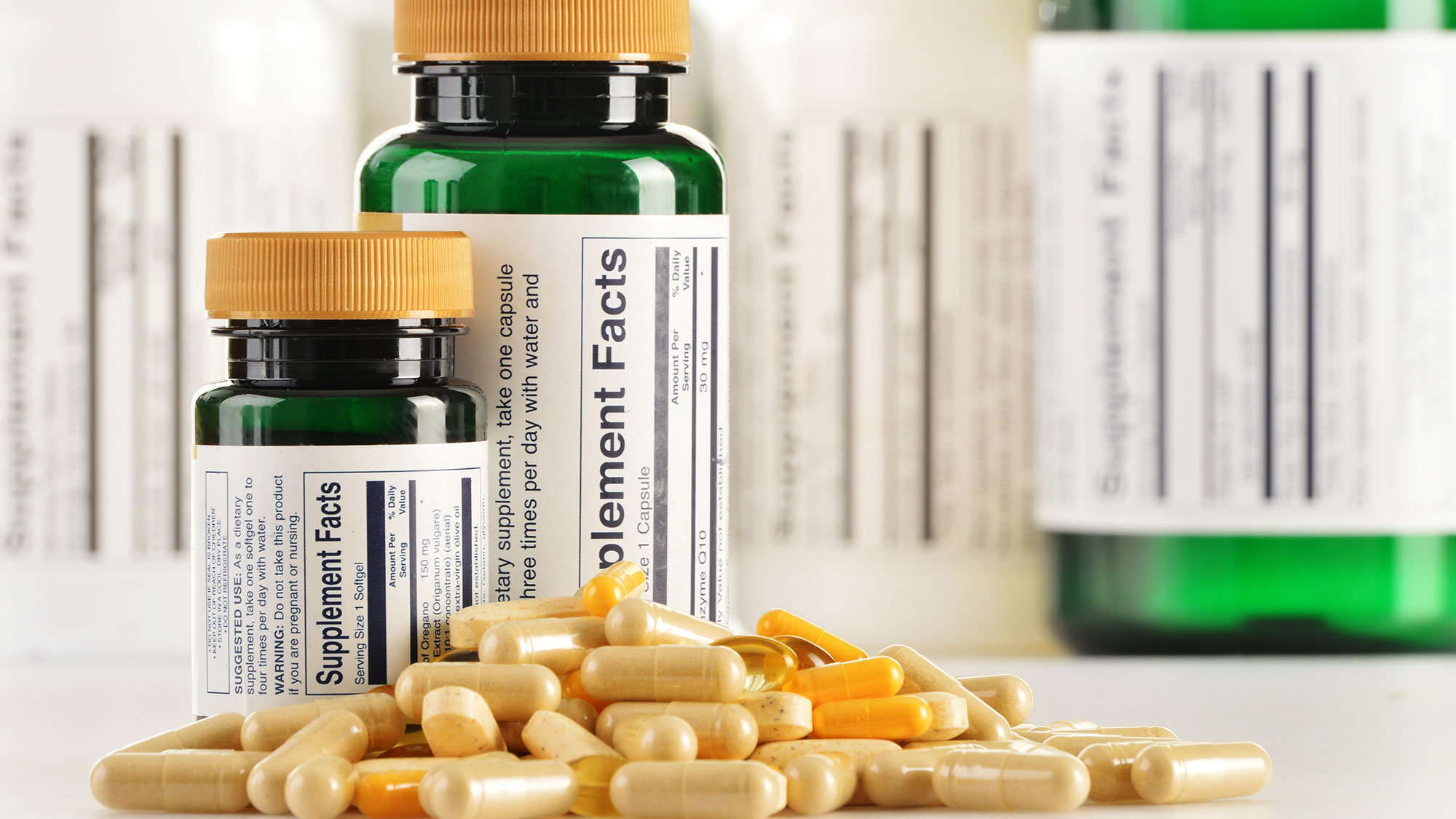 Bottles with dietary supplement pills.