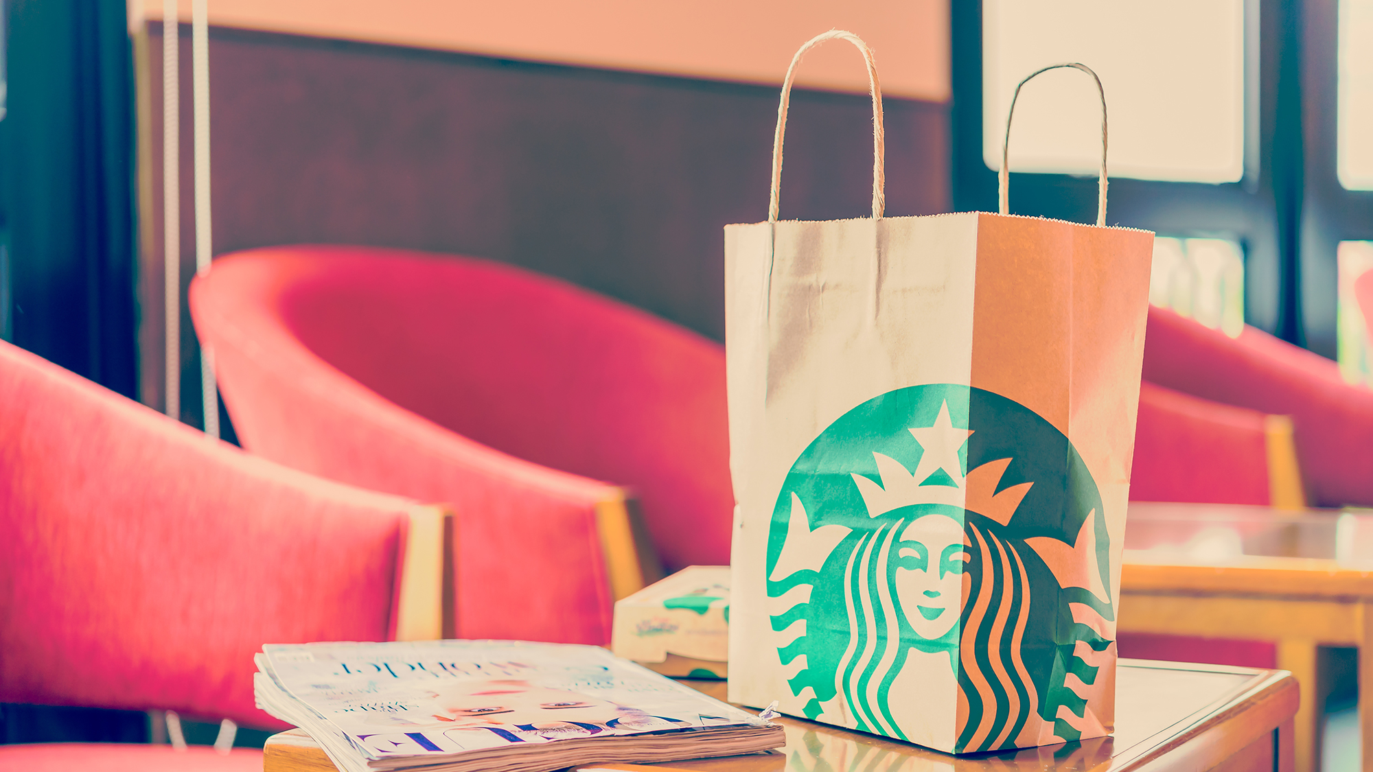 A Starbucks bag in a coffee shop.